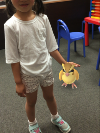 Daughter with Pidgey Pokémon